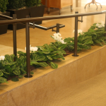 G32-Orchids-and-green-plants-under-railing